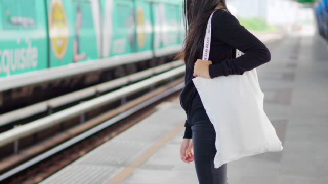 handbag in the girl's hand. - shopping bag stock videos & royalty-free footage