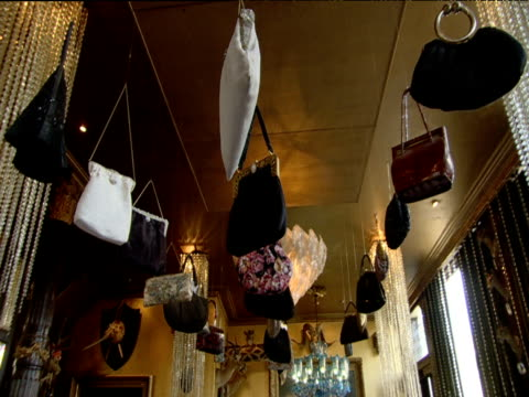 handbags hanging from ceiling of restaurant as weird decoration - ornate stock videos & royalty-free footage
