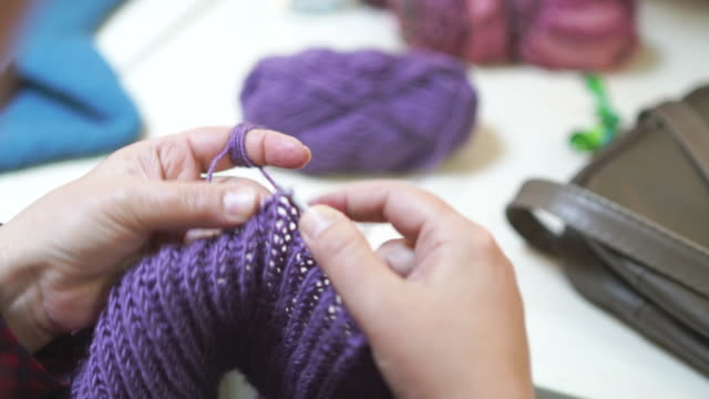 handcrafted traditional knitting. woman makes stitches with sewing needle. - knitting needle stock videos & royalty-free footage