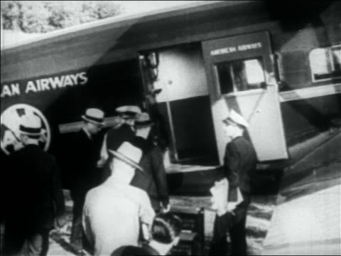 view handcuffed machine gun kelly being escorted into airplane / memphis - anno 1933 video stock e b–roll