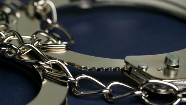 ecu handcuffs - law stock videos & royalty-free footage