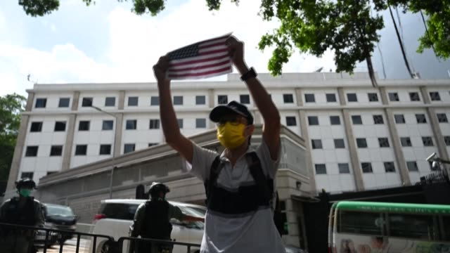 a handful of hong kongers display american flags in front of the us consulate to mark the us independence day heavy security was deployed at the us... - handful stock videos & royalty-free footage