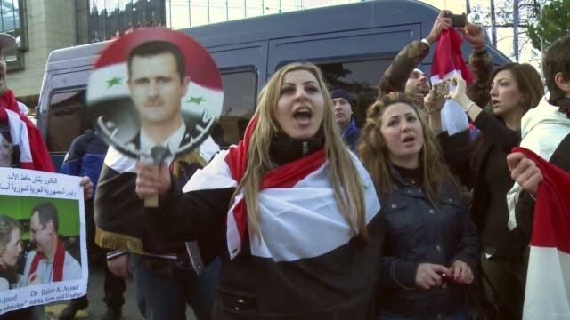 a handful of protesters gathered to express support for syrian president bashar alassad on wednesday as the geneva ii peace conference opened clean... - montreux stock videos and b-roll footage