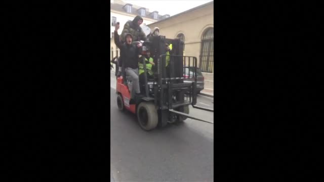a handful of protesters some wearing high visibility vests smash down a large wooden door leading to the ministry compound of french government... - benjamin griveaux stock videos & royalty-free footage