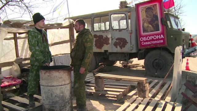 a handful of serbian militiamen have joined the prorussian activists taking up positions at road checkpoints to cement control over ukraine's... - peninsula stock videos & royalty-free footage