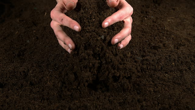 handful of soil, slow motion 4k - dirt stock videos & royalty-free footage