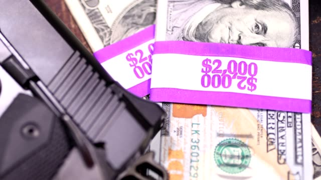 9mm handgun and stacks of $100 bills in $2000 wrappers. - drug cartel stock videos and b-roll footage
