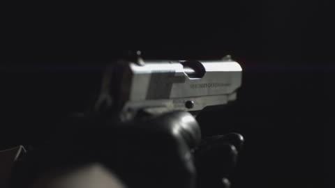 slo mo a handgun being fired / chicago, illinois, united states - handgun stock videos & royalty-free footage