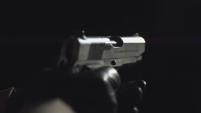 slo mo a handgun being fired / chicago, illinois, united states - arma da fuoco video stock e b–roll