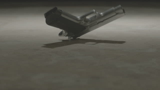 slo mo handgun falling to the floor / chicago, illinois, united states - schusswaffe stock-videos und b-roll-filmmaterial