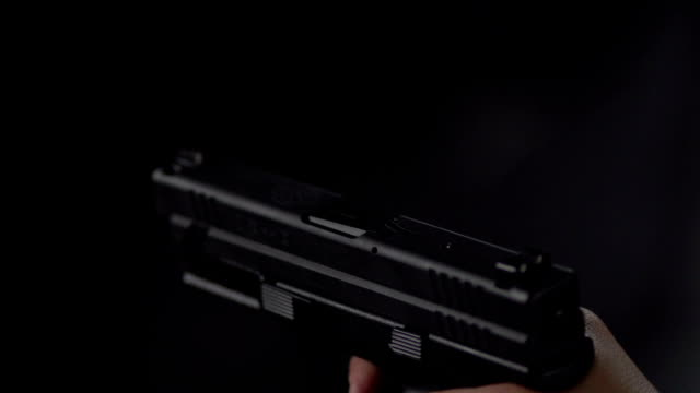 handgun fire in slow motion - handgun stock videos and b-roll footage