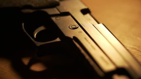 handgun on table - handgun stock videos & royalty-free footage