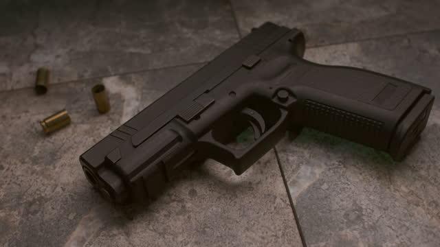 handgun on the floor with police lights - terrorism stock videos & royalty-free footage