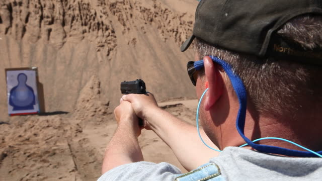 handgun target practice - ear protectors stock videos and b-roll footage