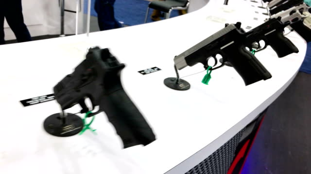 handguns are displayed at the sar usa booth during nra annual meeting exhibits at the kay bailey hutchison convention center on may 5 2018 in dallas... - national rifle association stock videos & royalty-free footage