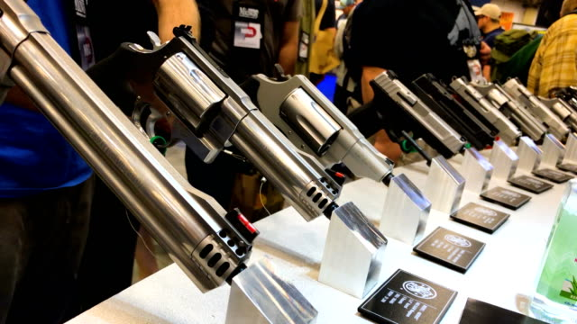 Handguns are displayed at the Smith and Wesson booth during the NRA Annual Meeting Exhibits at the Kay Bailey Hutchison Convention Center on May 5...