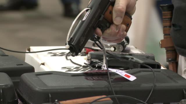 handguns for sale at showmasters gun shows on march 23, 2013 in richmond, virginia - アメリカ憲法点の映像素材/bロール