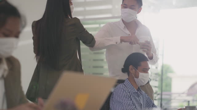 4k uhd handheld: businessperson do alternative greeting in new normal office lifestyle. they wear protective face mask and use elbow touch instead of handshake to reduce infection of coronavirus covid-19. - elbow stock videos & royalty-free footage