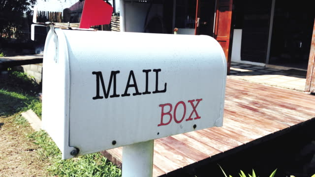 ms hand-held camera of u.s. white mail box in front of a house. - letter document stock videos & royalty-free footage