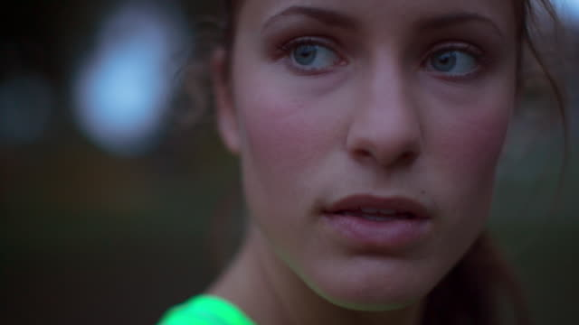 handheld close-up of tired female athlete looking away while taking breath - resting stock videos & royalty-free footage