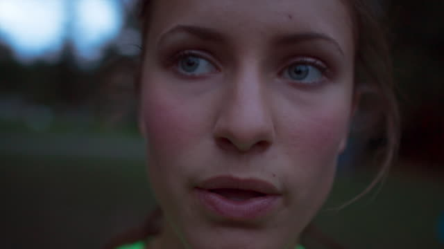 handheld close-up of tired female athlete taking breath - resting stock videos & royalty-free footage