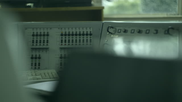 handheld, close-up, shot of a control panel, uk. - pannello di controllo video stock e b–roll