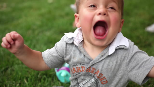 handheld closeup shot of a happy toddler with balloons. - toddler stock videos & royalty-free footage