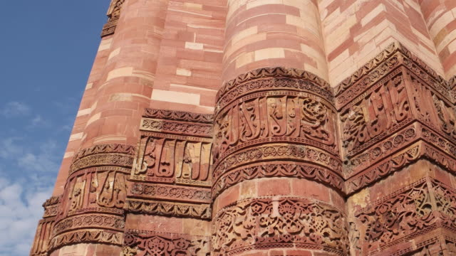 A handheld close-up view of the Qutab Minar and it's engravings, stabilized with a 3 way gimbal
