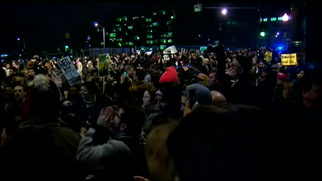 handheld, exterior of uic pavilion in chicago, illinois at night. crowd yelling, celebrating, and cheering after trump rally is canceled as they exit... - 2016 united states presidential election stock videos & royalty-free footage