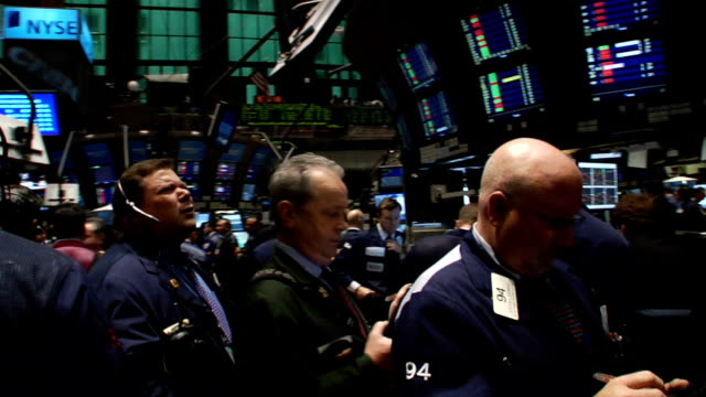 handheld eyelevel swivel view past traders and monitors on trading floor of new york stock exchange new york city - 2008 stock videos and b-roll footage