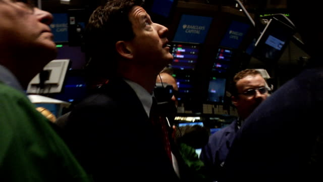 handheld eyelevel view of traders and monitors on trading floor of new york stock exchange new york city - 2008 stock videos and b-roll footage