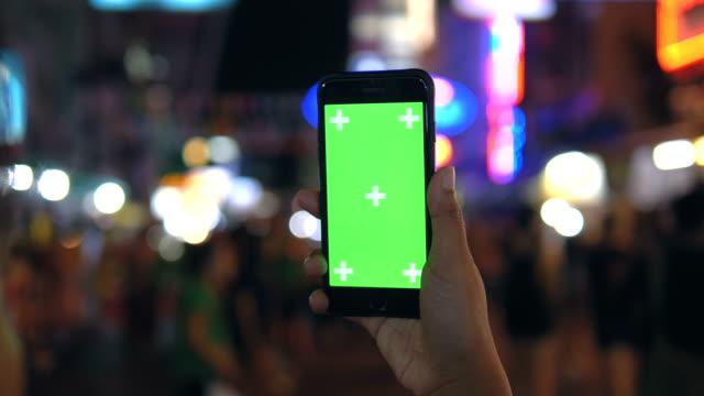 Handheld Green Screen at walking street