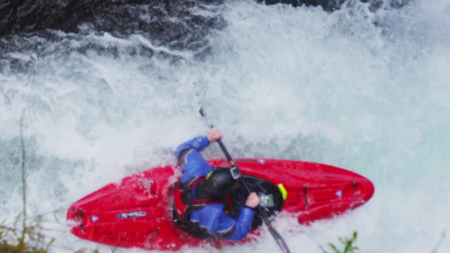 handheld high angle view of whitewater kayaker descending waterfall - columbia river gorge stock videos & royalty-free footage