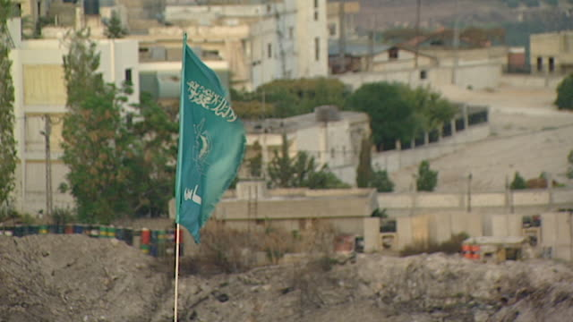 hand-held high-angle view of a hamas flag flying over the mieh mieh palestinian refugee camp near saida. - palestine liberation organisation stock videos & royalty-free footage