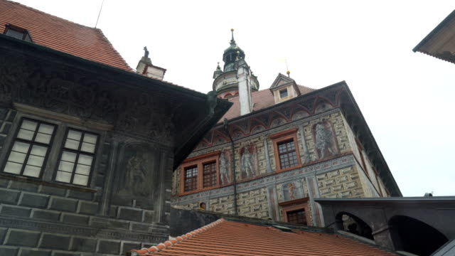 handheld low angle view while traveling by walking to see český krumlov tower - czech culture stock videos & royalty-free footage