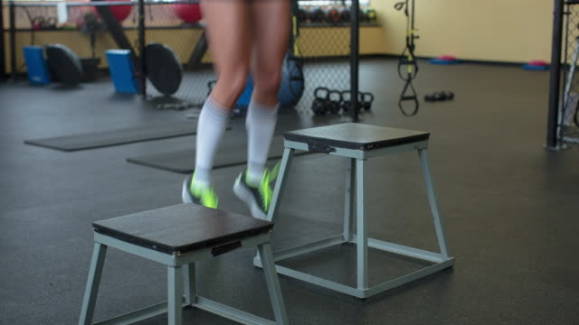 handheld low section of woman jumping on stool at gym - stool stock videos & royalty-free footage