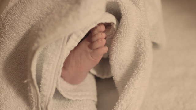 ecu handheld of newborn baby's foot  wrapped in hospital blanket - towel stock videos & royalty-free footage