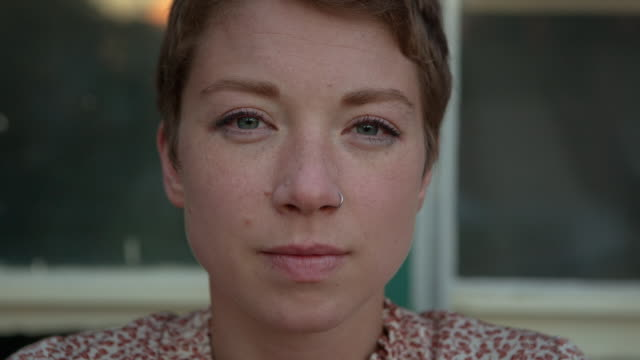 Handheld portrait of woman wearing nose ring