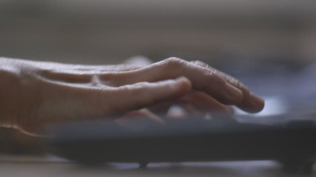 handheld selective focus view of hands using keyboard - desktop pc stock-videos und b-roll-filmmaterial