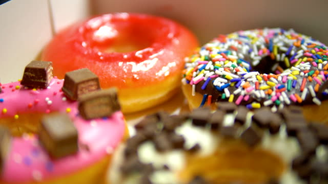 handheld shot : delicious sweet donuts. - doughnut stock videos & royalty-free footage
