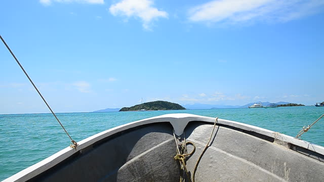 hand-held shot: fishing boat heading to the islands - full hd format stock videos & royalty-free footage