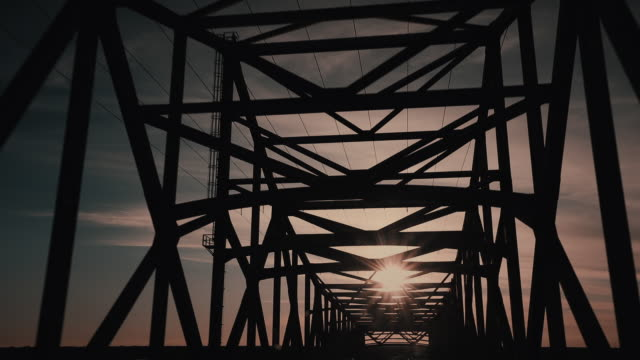 handheld shot from a car whilst crossing a bridge at sunset, louisiana, united states of america - stab stock-videos und b-roll-filmmaterial