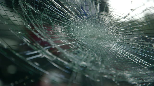 handheld shot from within a car of a damaged windscreen, uk. - incidente automobilistico video stock e b–roll