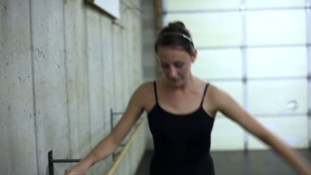 handheld shot of a ballet dancer rehearsing. - barre stock videos and b-roll footage