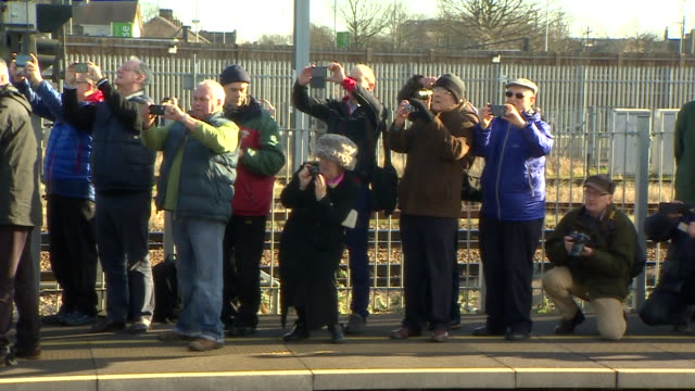 pov handheld shot of a crowd filming the departure of the flying scotsman - railway station stock videos & royalty-free footage