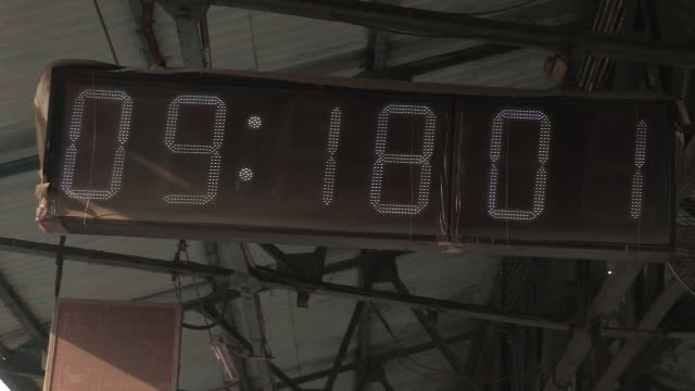 handheld shot of a digital clock on a mumbai station platform, maharashtra, india. - digital clock stock videos & royalty-free footage