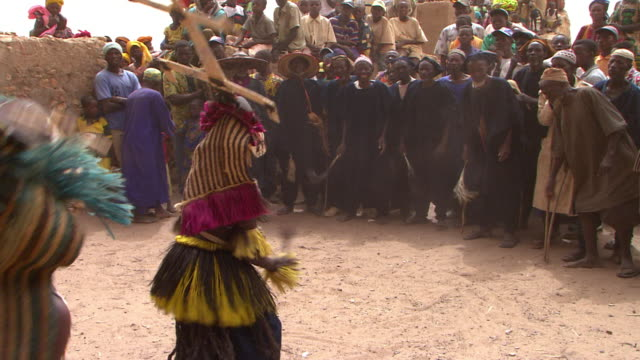 handheld shot of a dogon mask dance - minority groups stock videos & royalty-free footage