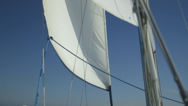 handheld shot of a moving yacht's rigging, uk. - aboard stock videos & royalty-free footage