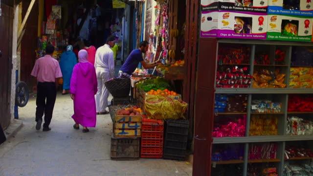 Handheld shot of a souk inside the medina quarter of Fes, Morocco
