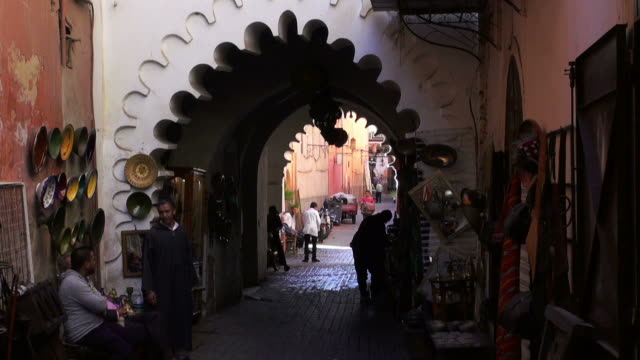 Handheld shot of an alley in the medina quarter of Marrakesh